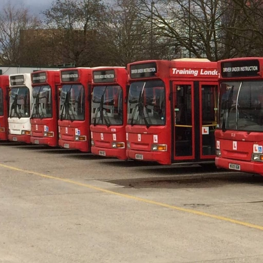 7 buses parked together